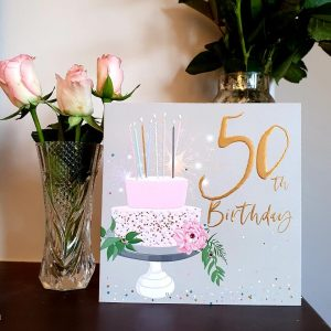 A large luxury 50th birthday card with a cake and candles, embellished with clear crystal gem stones and gold foiled lettering that reads 50th Birthday