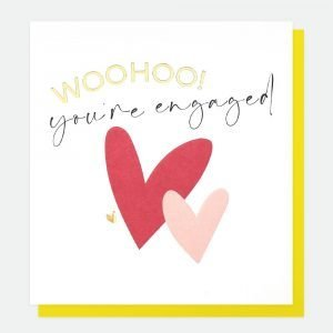 A card from British designer Caroline Gardner with hearts printed on the front of the card and the words'Woohoo You're Engaged' embossed and printed on the card. The card comes with a bright yellow envelope.