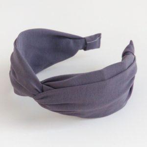 A lilac grey twist hairband from British designer CAroline Gardner.