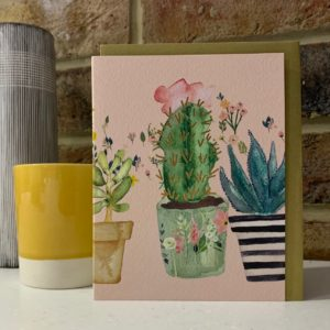 A card with an image of cactus plants on it with no wording.