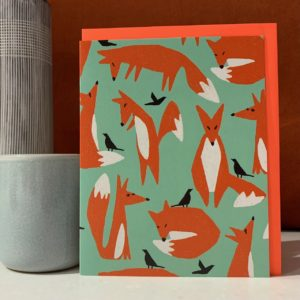 A card with images of foxes printed all over it