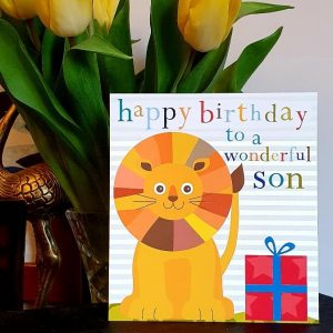A vibrant and colourful birthday card with a cute lion, a red present and Happy birthday to a wonderful son in colourful lettering