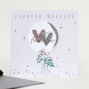 A lilac grey card with gold foil embossing. A lovely balloon with gold hearts and the words Diamond Wedding Happy Anniversary