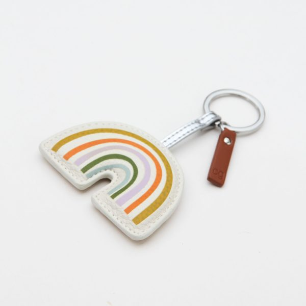A vibrant rainbow keyring with a silver keyring fastening and a leather tag on it. From British designer Caroline Gardner.