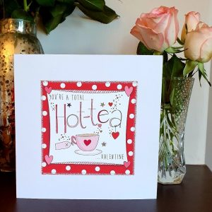 A valentines day card with the words You're A Total Hot-Tea Valentine hand finished with little silver stars and hand stitching.