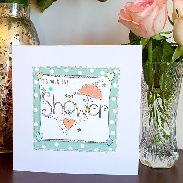 Pale blue and pinks It's your baby shower card with hand stitched edging