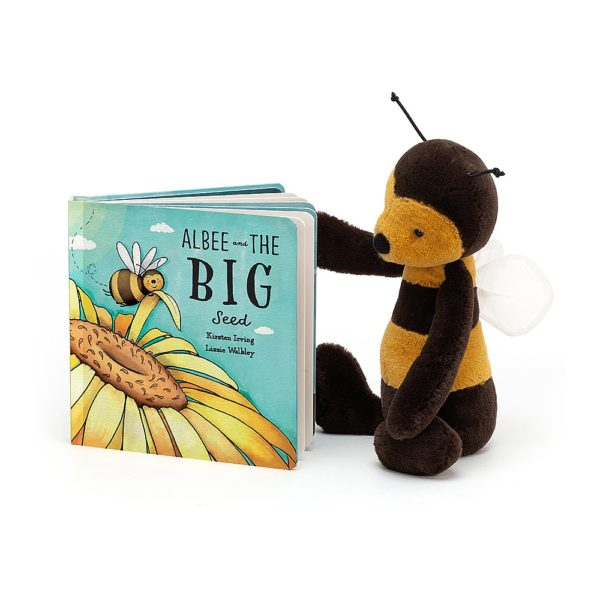 A cuddly Jellycat Bumble Bee looking at a hardbacked book which is also from Jellycat and is called Albee the Big Bee.