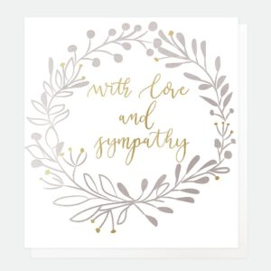 A white card with a wreath printed in gold foil and the words 'With love and sympathy printed in the centre of the wreath, from British designer Caroline Gardner.