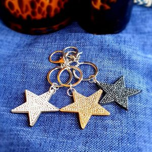 Glittery star key rings in a choice of gold, clear or black