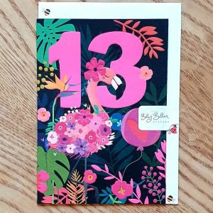 A neon bright flamingo 13th birthday card with a floral pink flamingo and a big pink 13