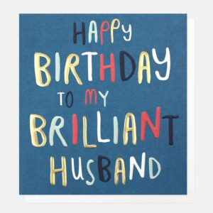 A blue card with the words 'Happy Birthday to my Brilliant Husband' printed in different colours on it.