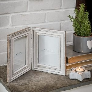 A double photograph frame in white distressed paint finish