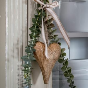 A natural wood hanging heart for your home. A chunky heart with a coffee and cream hanging ribbon