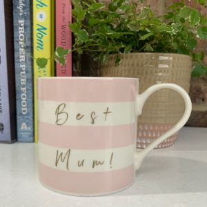 A pink and white striped bone china mug with the words Best Mum printed in gold sonf with a little pink heart and kisses printed on the inside of the mug.