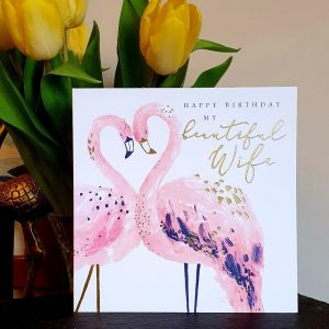 A birthday card for your wife with two beautiful flamingos caressing to create a heart shape with their head and necks. Gold foil highlights make the card really special. Happy Birthday my beautiful Wife.