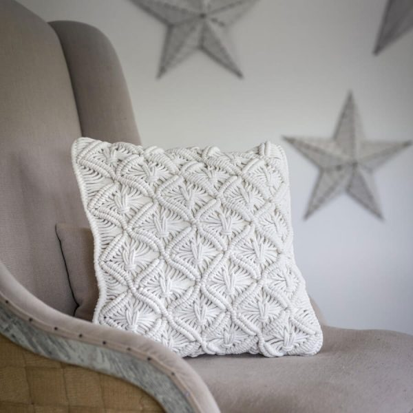 A 40cm square hand woven macrame cushion. Made with natural cream cotton rope, woven with a diamond style pattern.
