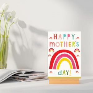 A colourful card with rainbows all over it and the words Happy Mother's Day printed on it.