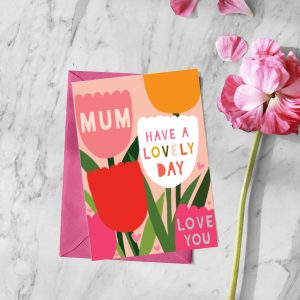 A colourful card with images of tulips and the words Mum Have a lovely day Love You printed on it.