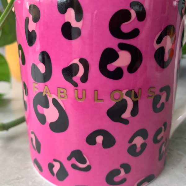 A bone china mug with vibrant pink leopard print design and the word Fabulous printed in gold.