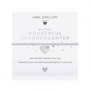 A children's elasticated silver plated beaded bracelet on a white card from Joma jewellery. The bracelet has a silver and rose gold heart charm and the card reads Wonderful Granddaughter - wear this little bracelet every day because you're a wonderful granddaughter in every way. Comes with a gift card for your own message and wrapped in a gift bag tied with a satin ribbon