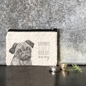 A cotton zip coin purse with a picture of a pug and the words Happiness is just a biscuit away
