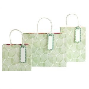 White gift bags with a delicate green leaf pattern. Available in 3 sizes with a white rope handle and a green tag.