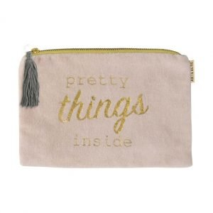 A dusky pink velvet pouch with a blue silky lining. The front of the pouch has printed in gold pretty things inside. Zip fastening with a grey tassel