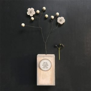 A wooden block with wire and wood flowers. The block is printed with You're the Mum everybody wishes they had.