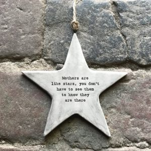 A grey ceramic rustic hanging star printed with the words Mothers are like stars you don't have to see them to know they are there.