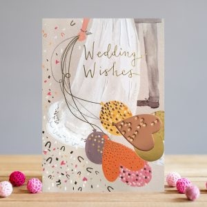 A beautiful card from Louise Tiler. The image is of a couple on their wedding day. The bride with a long flowing dress is holding some balloons and there is a confetti effect all over the card.