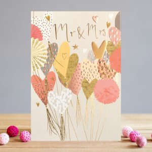 A card from Louise Tiler which is covered in colourful balloons with the words Mr & Mrs embossed foiled and printed on it.