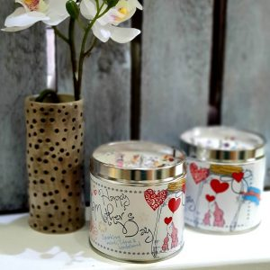 A scented candle in a tin with the tin decorated with Happy Mother's Day
