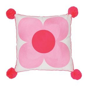 A large cotton cushion with a red pom pom at each corner and an embroidered flower that fills the front cover. The flower has 4 pale pink petals and a large red centre. Removeable cover and polyester filled inner made from recycled plastic bottlesA