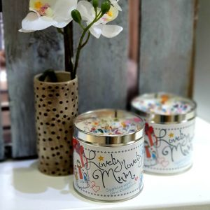 A scented candle in a tin with the tin decorated with Lovely Lovely Mum