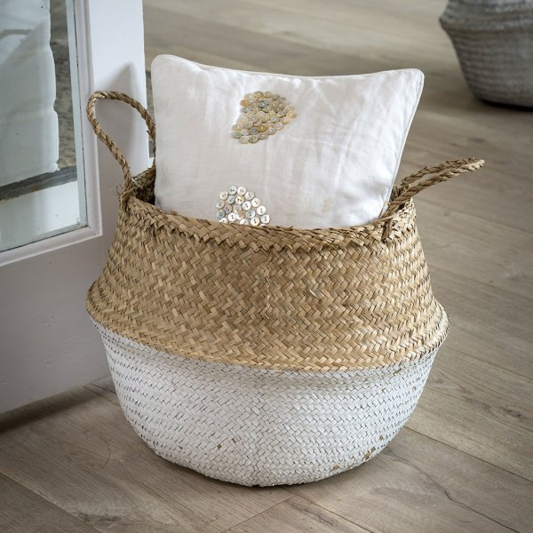 A basket with handles which has a white dipped effect. The basket is made from Seagrass and comes from design company Retreat Home.