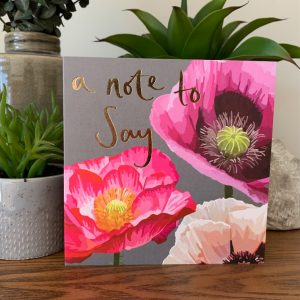A gorgeous card from Sarah Kelleher with painted open flowers and the words A Note to Say printed and finished in foil effect.