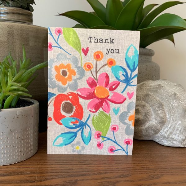 A colourful card from Sarah Kelleher with flowers all over it. The words Thank You are printed at the top of the card.