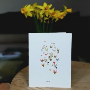 A card with little hearts all over in gold pinks and neutral tones. A perfect card for ananniversary, engagement, wedding or just to say I love you