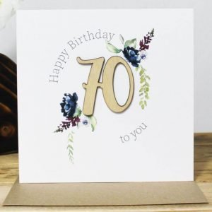 A 70th birthday card with a wooden laser cut 70 and clear crystals. Happy Birthday to you