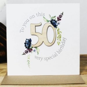 A 50th birthday card with a wooden laser cut 40 and clear crystals. To you on this very special birthday
