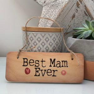A rustic wooden hanging sign with the words Best Mam Ever printed on it.