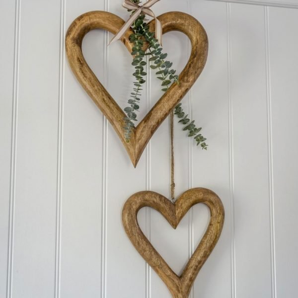 A pair of mango wood chunky hollow hearts with a twine hanger. Available in two sizes