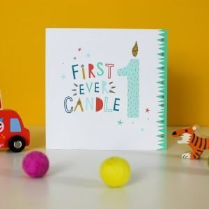 A cute card with a blue candle made from a number 1 and with the words first ever candle printed on it.