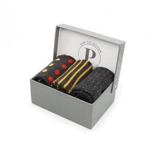 Three pairs of men's bamboo socks with stripes, spots and plain in mustard, red and grey presented in a gift box