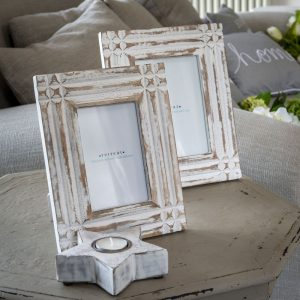 A wooden white washed 5 x 7 picture frame
