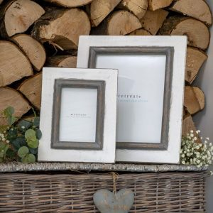 A large white wooden frame with grey trim around the photograph. Fits an 8 x 10 photograph.