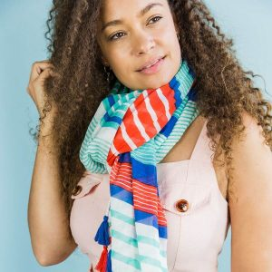 100% cotton scarf in white with multiple stripes and tassels in navy, aqua and red