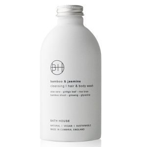 A white bottle with a silver screw cap which holds 330 ml of Bamboo & Jasmine Hair and Body Wash