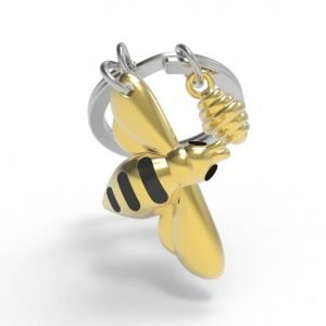 A metal bee key ring in gold and black