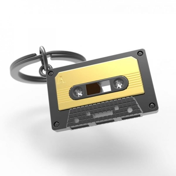 A grey and gold metal cassette tape keyring